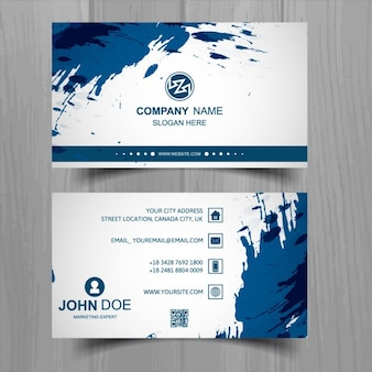 White business card with blue paint spots
