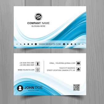 White business card with blue wavy shapes