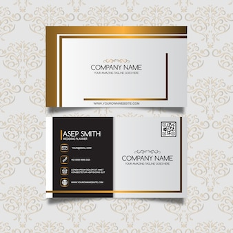 White business card with golden details