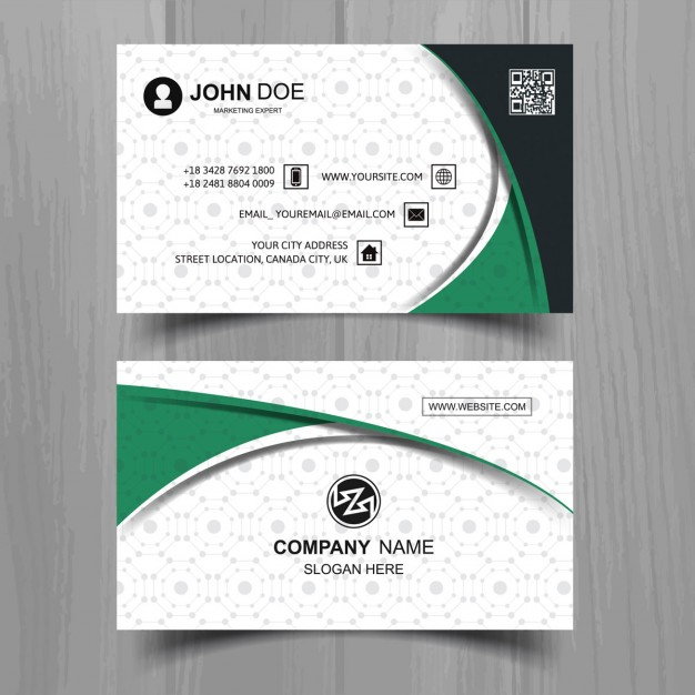 White business card with green elements