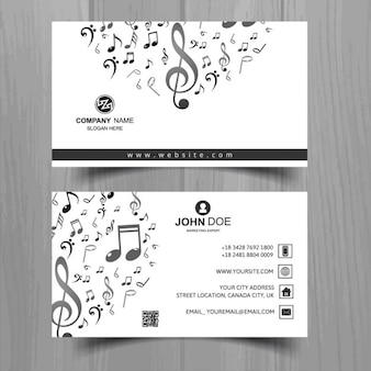 White business card with musical notes