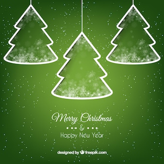 White christmas trees on green background