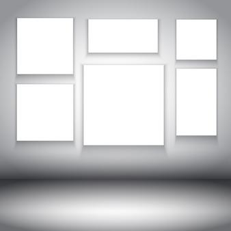 White frames in a gray room