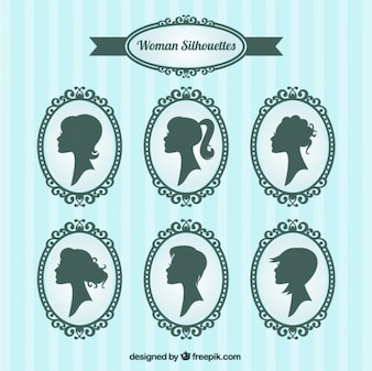 Woman silhouettes inside ornamental frames