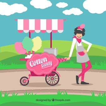 Woman with cotton candy cart in the park