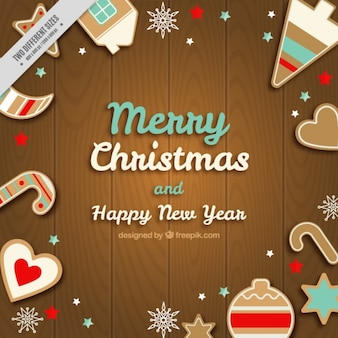 Wooden background of merry christmas and new year with gingerbread cookies