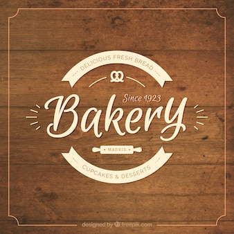 Wooden background with bakery badge