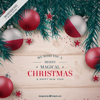Wooden background with christmas decoration balls and fir branches