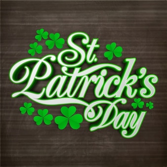 Wooden background with clovers for st patrick's day