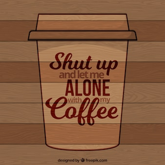 Wooden background with coffee phrase