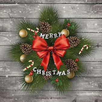 Wooden background with realistic christmas ornaments