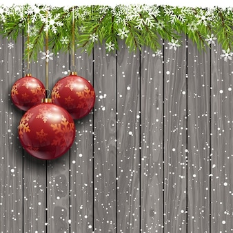 Wooden background with red christmas balls