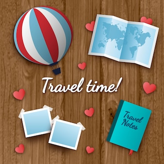 Wooden background with red hearts and travel objects