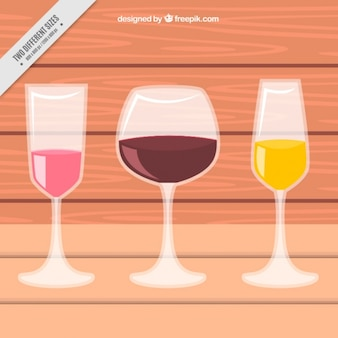 Wooden background with three wine cups