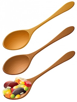 Wooden spoons with mixed fruit