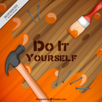 Wooden table with hammer and paintbrush background