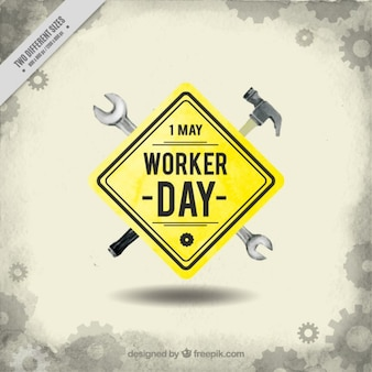 Worker day sign with tools background