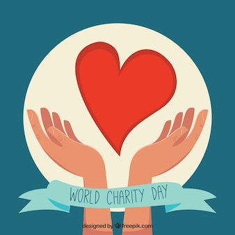 World charity day background of hands with a heart