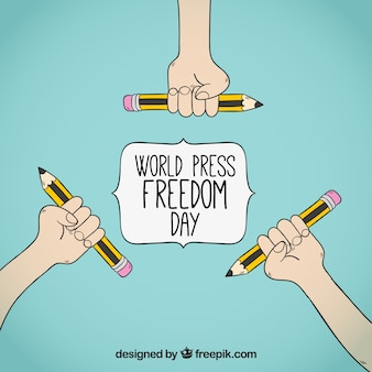 World press freedom day background with hands holding pencils