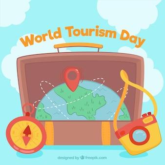世界の観光日、惑星地球を持つスーツケース