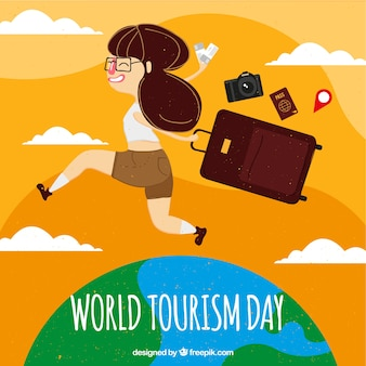 World tourism day, girl running over the world