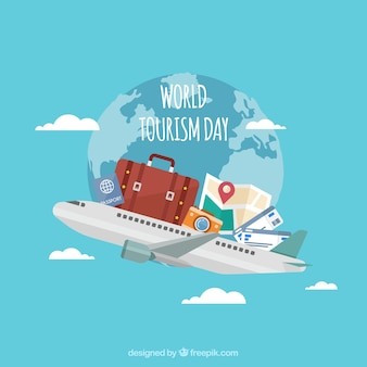 World tourism day, travel elements on a plane