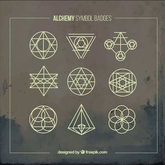 Yellow alchemy symbols badges
