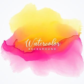 黄色とピンクの明るい水彩汚れの背景