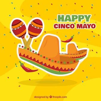 Yellow background with mexican hat and maracas