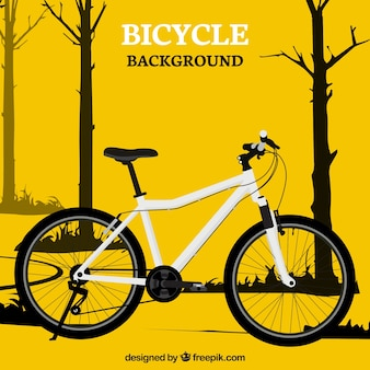 Yellow bike and trees background
