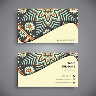 Yellow business card with a mandala