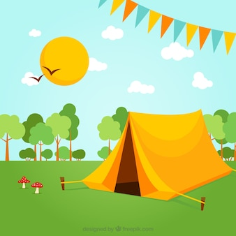 Yellow camping tent in a spring landscape