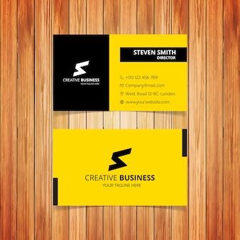 S letter logo黄色と黒色の最小企業名刺