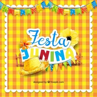 フェスタパーティーの伝統的な要素を持つ黄色のテーブルクロスの背景
