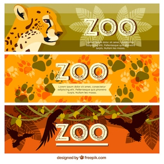 Zoo banners with wild animals and footprints