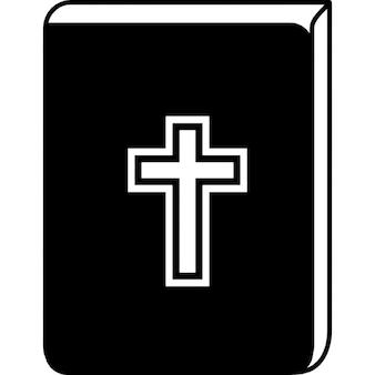 Bibel mit Kreuz-Zeichen vor