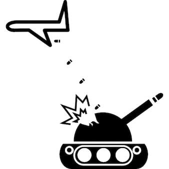 Aereo lanciando bombe su un serbatoio di guerra