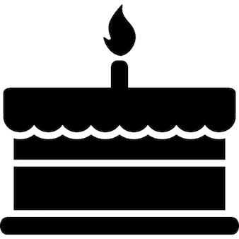 Torta di compleanno con una candela che brucia