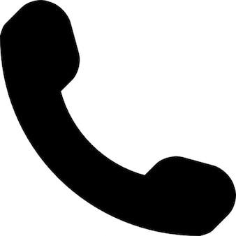 Telefoongesprek auriculaire symbool in zwart