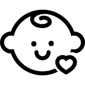 Cabeça do bebê com um pequeno esboço do coração