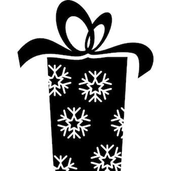 Caixa de presente de Natal com flocos de neve padrão e uma fita no topo