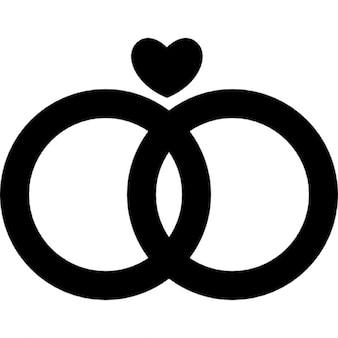 Casamento anéis casal com um coração