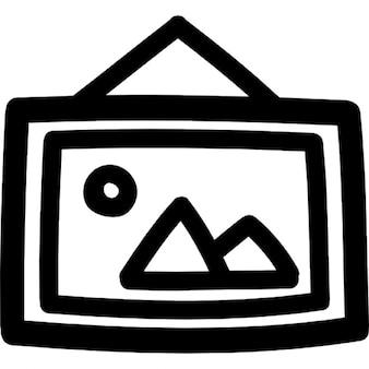 Quadro pendurado em um símbolo quadro desenhado à mão