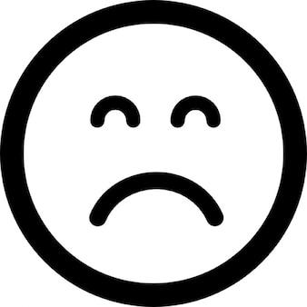 Triste rosto quadrado emoticon com os olhos fechados