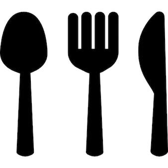 Fourchette de cuillère et silhouettes de couteaux restaurant de symbole