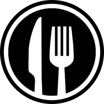 Fourchette et couteau couverts symbole d'interface de cercle pour le restaurant
