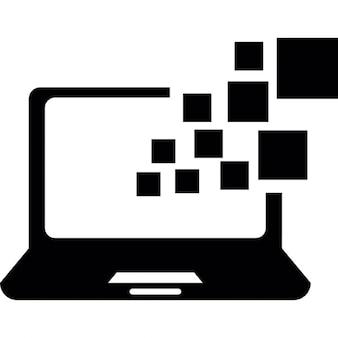 Ordinateur portable ouvert avec des boîtes de pixels