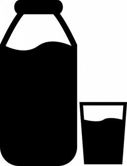 Botella de leche y un vaso