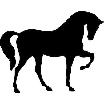 Caballo de pie sobre tres patas forma negro de la vista lateral