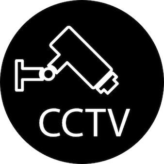 De cámara y de video de CCTV de vigilancia signos en un círculo